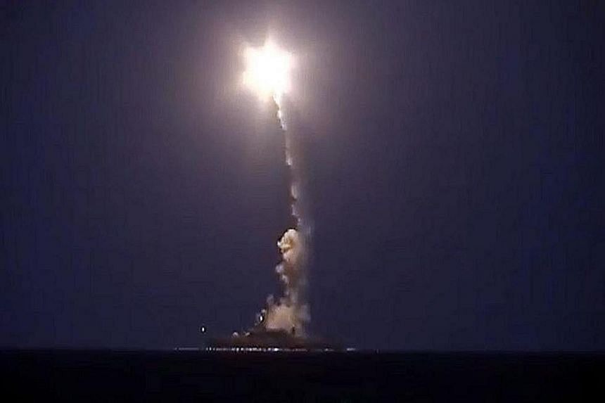 A Russian warship reportedly launching a cruise missile in the Caspian Sea in a strike against Islamic militants in Syria, in a screen grab from a video released by the Russian Defence Ministry on Oct 7. The European Aviation Safety Agency's warning