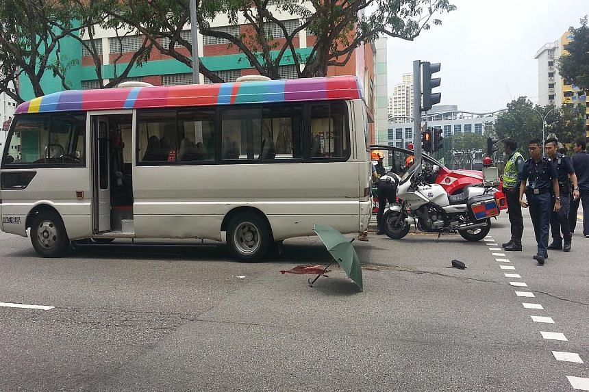 The accident scene at Toa Payoh Lorong 1, outside Braddell MRT Station, yesterday, when a woman was knocked down by a minibus. Her right leg was badly injured.