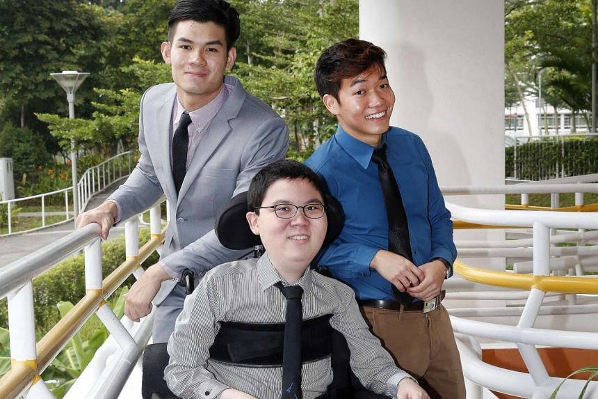 (From left) Mr Bryan Chong, 22, Mr Shalom Lim, 20, and Mr Josiah Ong, 22, received the Asia Pacific Breweries Foundation Scholarship for Persons with Disabilities yesterday at the SPD Ability Centre. It is the eleventh year the scholarship, which sup