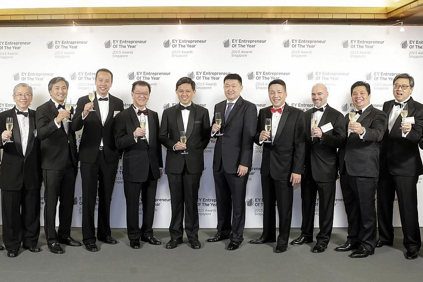 Celebrating at the awards ceremony yesterday were (from left) Mr Wong Ngit Liong, chairman and CEO of Venture Corp and chairman of EOY Singapore Academy; Dr Michael Tan, group CEO and co-founder of Fullerton Healthcare Group; Mr Mark Lee, CEO of Sing