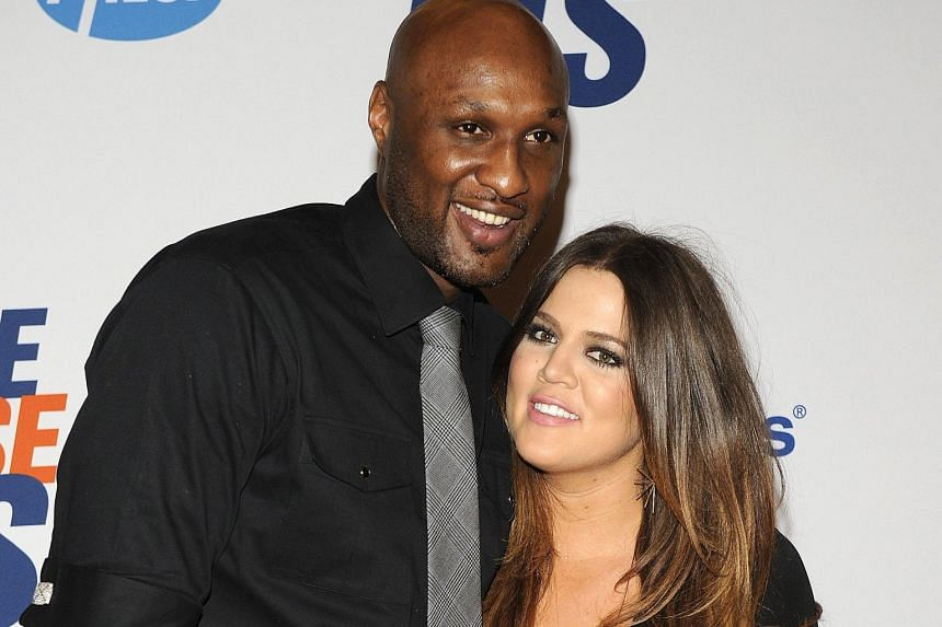 Two-time NBA champion Lamar Odom in happier times with former wife Khloe Kardashian. He was found unconscious in a brothel.