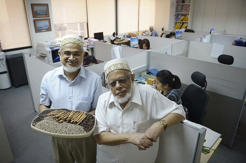 (Above): Spice trader Moez Nomanbhoy (right) and his son Hanif. (Left): An old photograph of Mr Moez Nomanbhoy (with his youngest grandson Aliasger on his lap). Standing: Mr Hanif (right) with his daughter Sakina and son Aqeel.