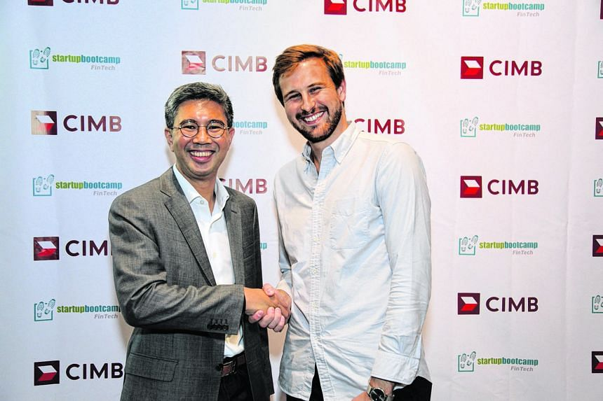 CIMB Group CEO Zafrul Aziz (below, left) with co-founder of Startupbootcamp FinTech Markus Gnirck. The bank is partnering the company to mentor start-ups.