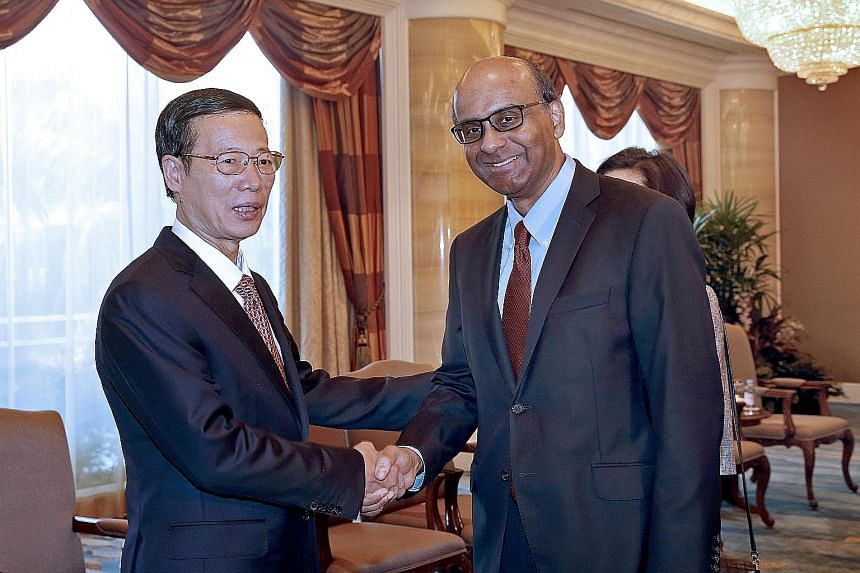 China's Vice- Premier Zhang Gaoli met Deputy Prime Minister and Coordinating Minister for Economic and Social Policies Tharman Shanmugaratnam yesterday on the last day of his three-day visit. They discussed progress in financial cooperation, and agre