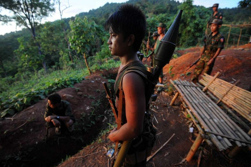 This file picture shows soldiers from the All Burma Students Democratic Front at an outpost on the Laja Yang frontline. The armed group is among eight which signed a ceasefire accord with the Myanmar government on Oct 15, 2015.