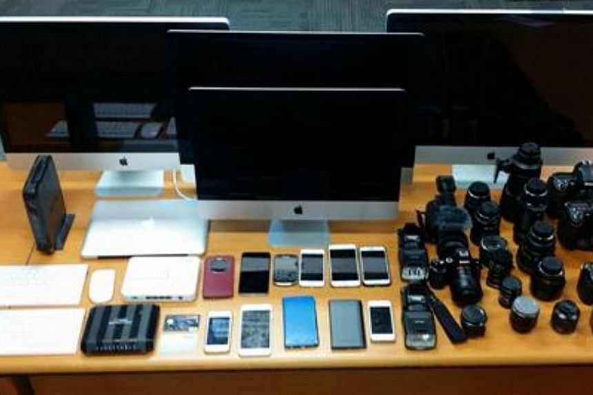 Computers, mobile phones, documents, cameras and clothing apparel were seized as case exhibits.