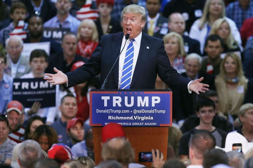 Republican presidential candidate Donald Trump addressing a crowd of more than 7,000 people at the Richmond International Raceway on Oct 14 in Virginia.