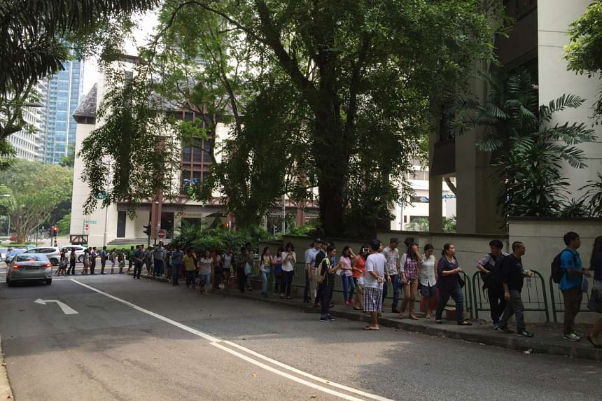 Myanmar nationals queueing up outside the Embassy of the Republic of Myanmar at St Martin's Drive on Thursday, Oct 15, 2015, to cast their votes.