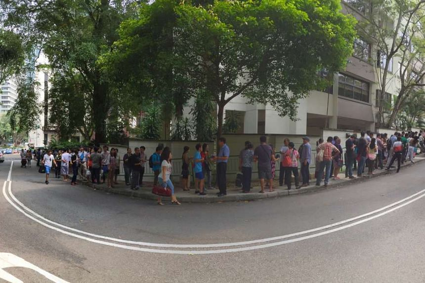 As at 2.30pm. the queue stretched all the way to Tanglin Road.