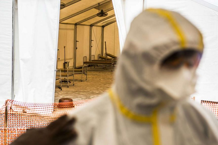 Empty beds for patients sit in a tent at an Ebola treatment centre in Coyah, Guinea, on Sept 10.
