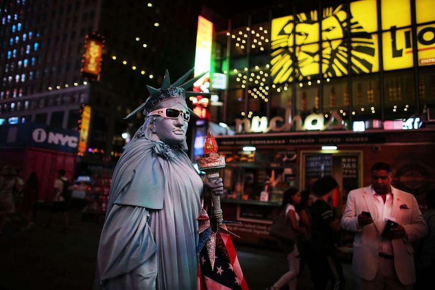 A street performer works for tips in Times Square on Aug 19, 2015 in New York City.