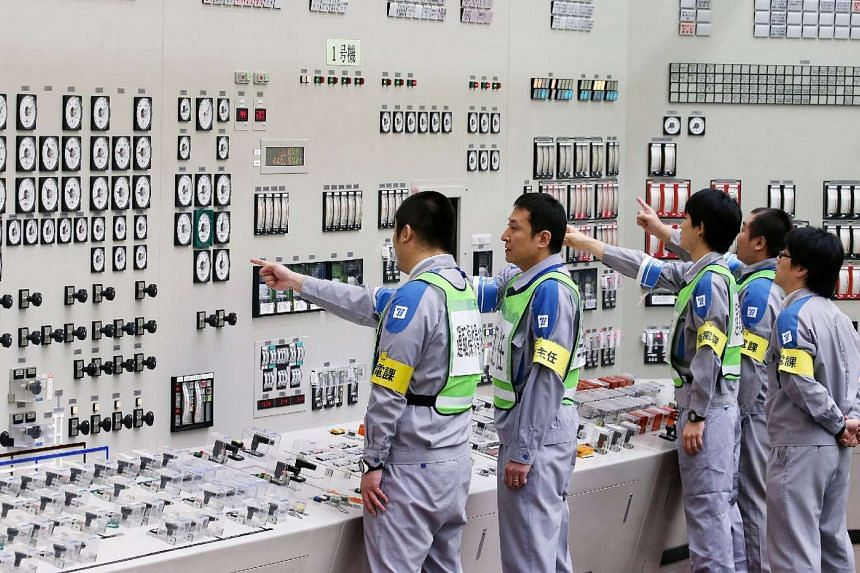 Operators making checks in the central control room of the Sendai nuclear power plant on Aug 14.