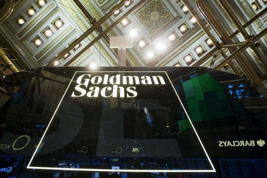 A Goldman Sachs sign is seen above the floor of the New York Stock Exchange shortly after the opening bell in the Manhattan borough of New York, in this Jan 24, 2014.