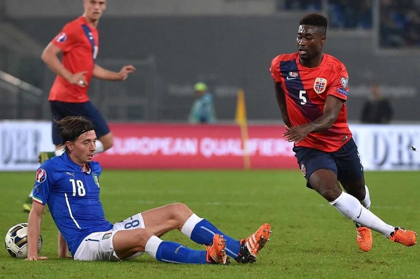 Alexander Tettey (right) got Norway's bid to qualify directly off to a bright start with a goal but Italy bounced back with two goals to seal their spot at the top of Group H.