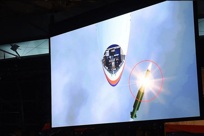 A computerised reconstruction, shown at the release of the report on MH17, showing a Buk missile exploding near the airliner's cockpit. Russia claims that the missile which hit the plane was from an older batch no longer used by its armed forces.