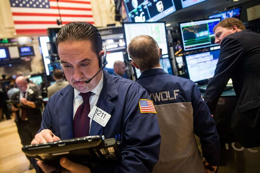 A trader works on the floor of the New York Stock Exchange. PHOTO: AFP