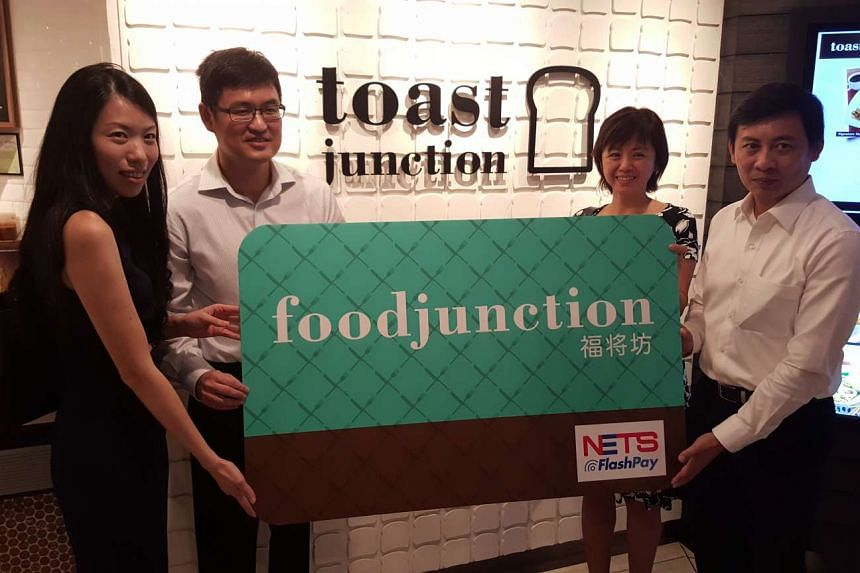 (From left) Chief operating officer of Food Junction Gwyn Sin, Group CFO of Auric Pacific Group Tan Kai Teck, Chief operating officer of Nets Jocelyn Ang, Chief executive officer of Nets, Jeffrey Goh. Use of the Nets Flashpay RSVP card gives customer