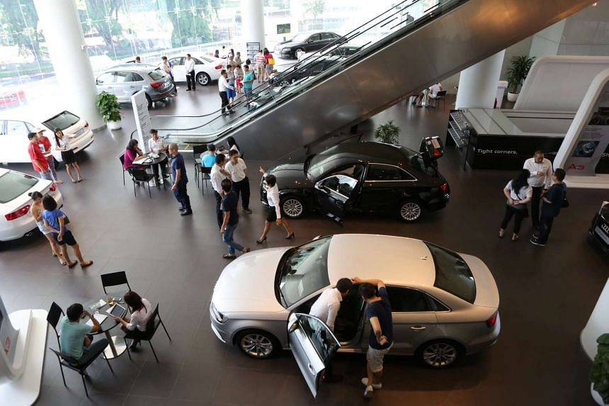 People at the Audi showroom at Alexandra Road in 2014.