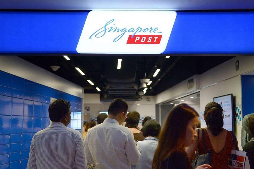 Customers at a SingPost branch at Raffles Place.
