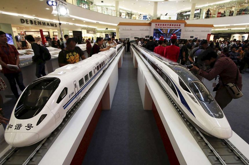Models of high speed trains are displayed during the China High Speed Railway on Fast Track exhibition in Jakarta, Indonesia, August 13, 2015.