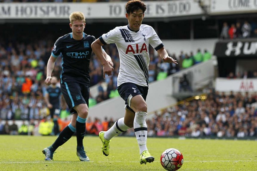 Tottenham Hotspur's South Korean midfielder Son Heung-min runs with the ball during the English Premier League football match between Tottenham Hotspur and Manchester City at White Hart Lane in north London on Sept 26, 2015.