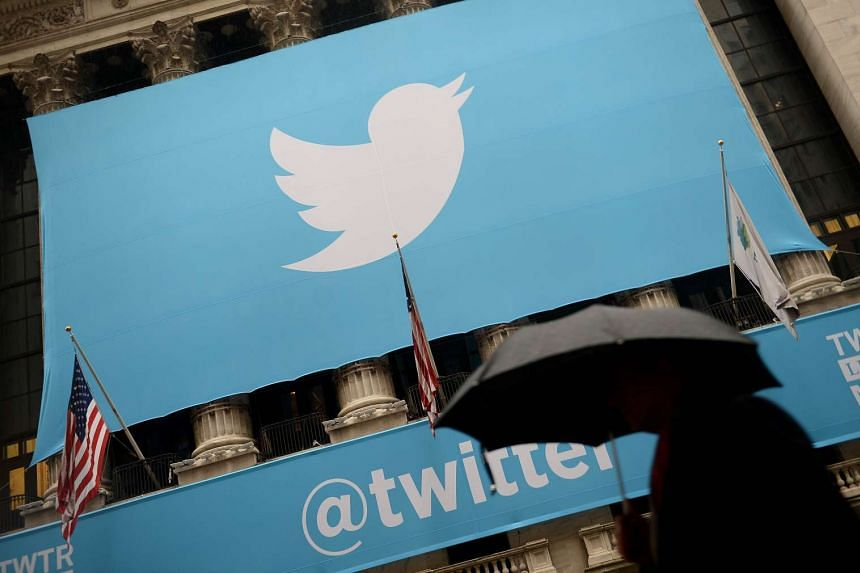 In this Nov 7, 2013 file photo, a banner with the logo of Twitter is set on the front of the New York Stock Exchange in New York.