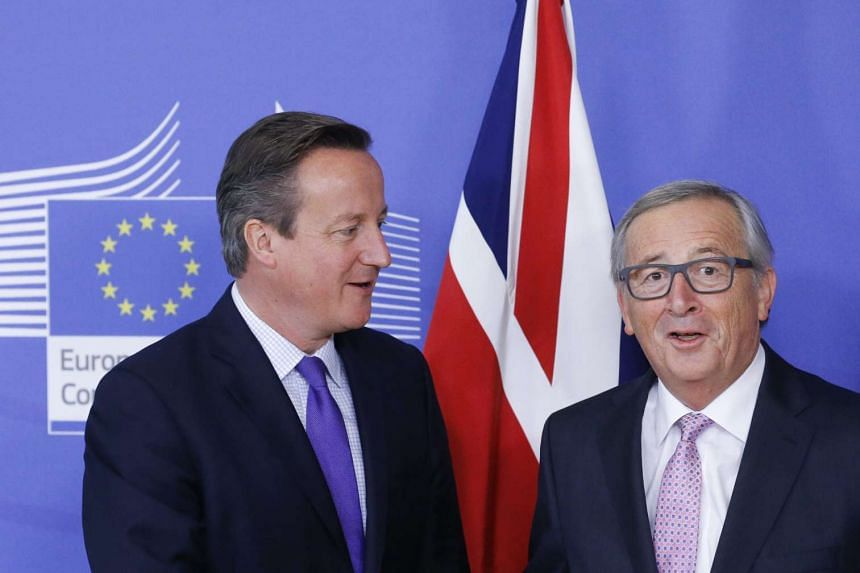 British Prime Minister David Cameron (left) is welcomed by European Commission President Jean Claude Juncker (right) prior to a meeting ahead of the EU Summit in Brussels, Belgium, on Oct 15, 2015.