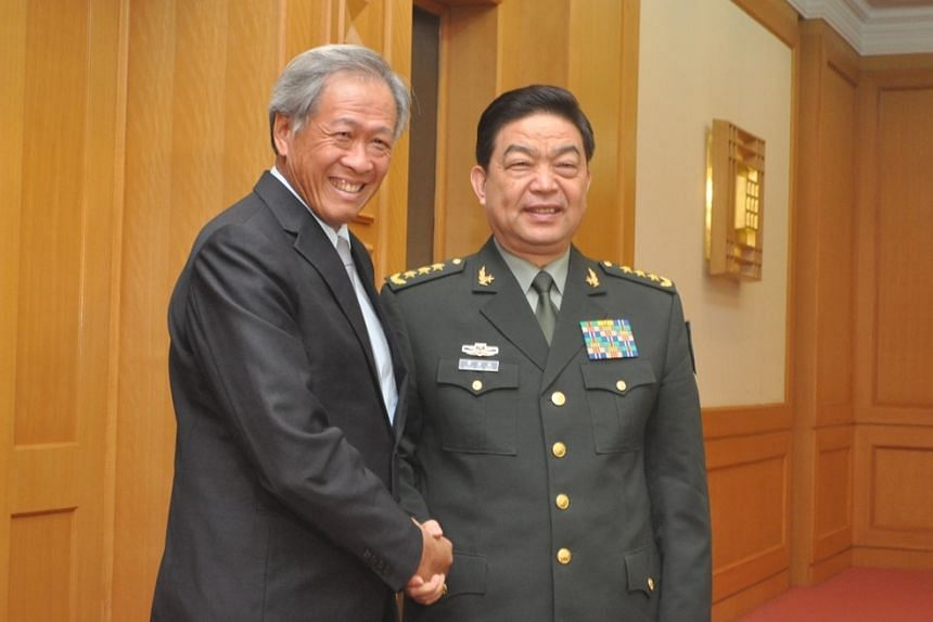 Defence Minister Ng Eng Hen (left) meeting his Chinese counterpart Chang Wanquan on the first day of his visit to China and on the sidelines of the Asean-China Defence Ministers' informal summit in Beijing, on Oct 15.