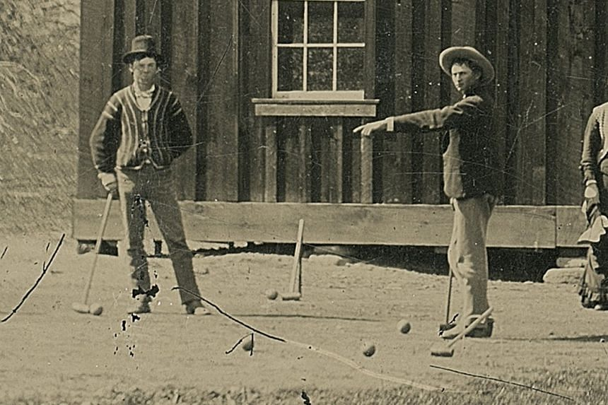 This tintype photograph of gunslinger Billy the Kid (left) playing croquet with accomplices from his gang has been valued at US$5 million.