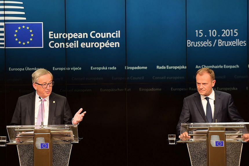 European Commission President Jean-Claude Juncker (left) and European Council President Donald Tusk addressing a press conference after an European Council leaders' summit on Oct 15, 2015.