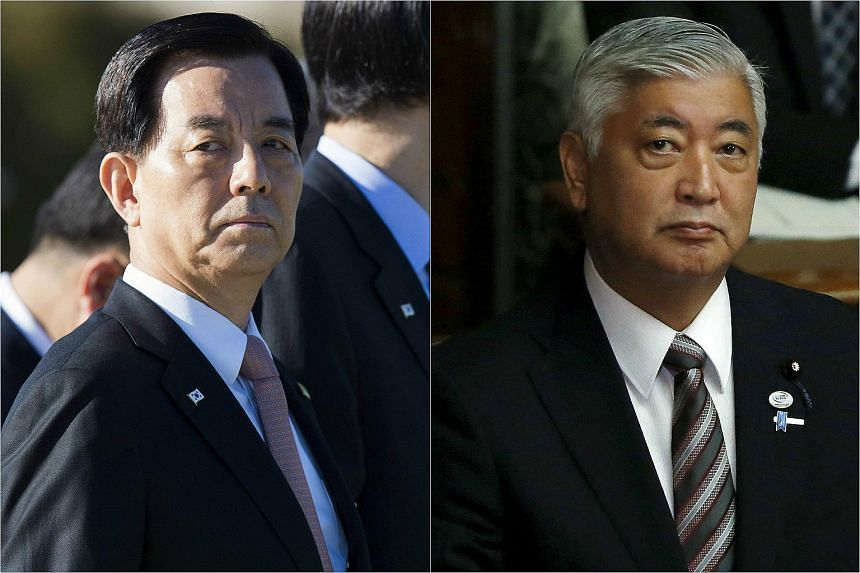 South Korean defence minister Han Min Koo (left) and his Japanese counterpart Gen Nakatani will hold talks ahead of a trilateral leadership dialogue involving the two countries and China.