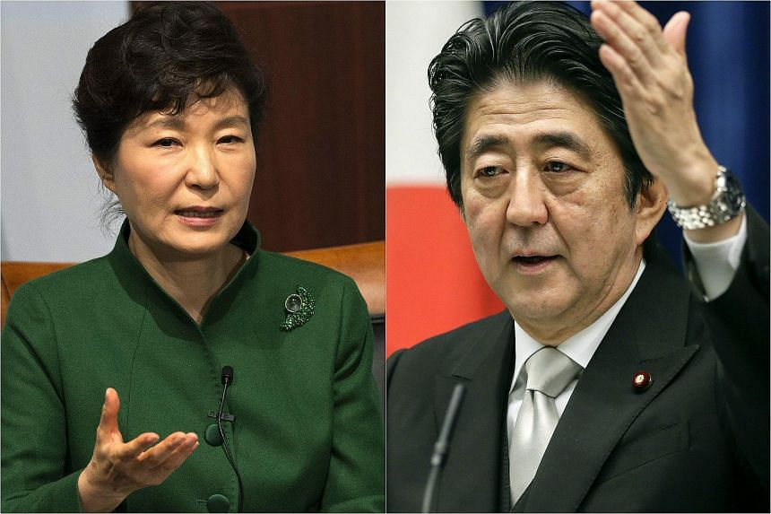 South Korean President Park Geun Hye (left) has signalled she might hold a long-avoided summit with Japanese Prime Minister Shinzo Abe.