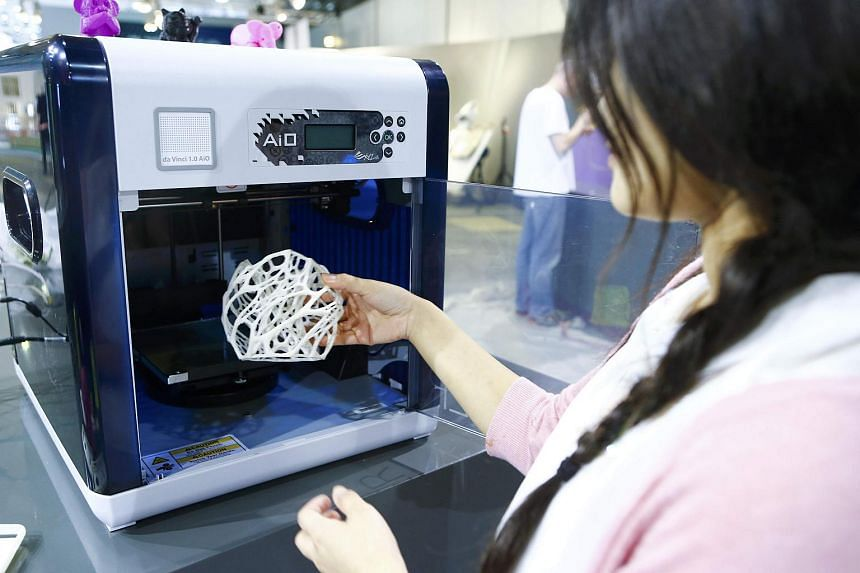 A Da Vinci 1.0 AiO 3D printer is displayed at the IFA Electronics show in Berlin on Sept 2.