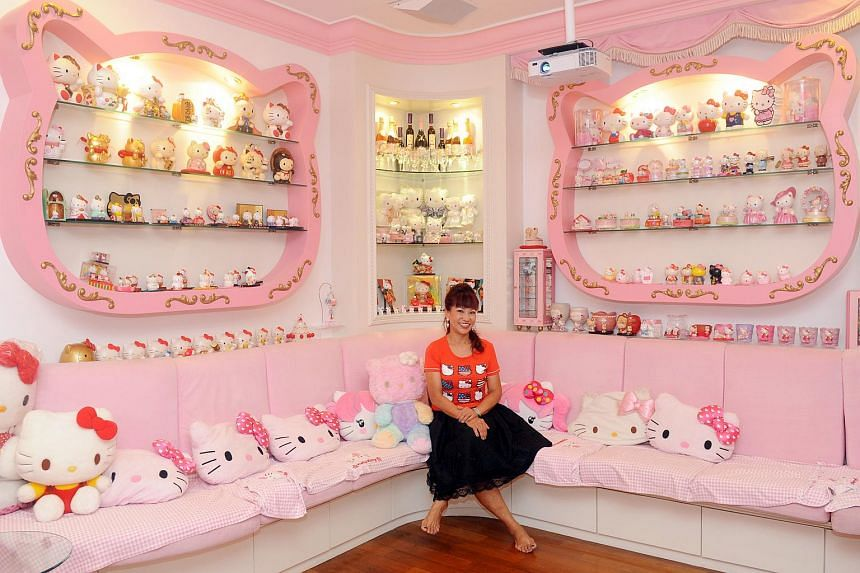 Madam Connie Sim in her karaoke room, flanked by Hello Kitty plushies, figurines and other memorabilia that she collected over the years.
