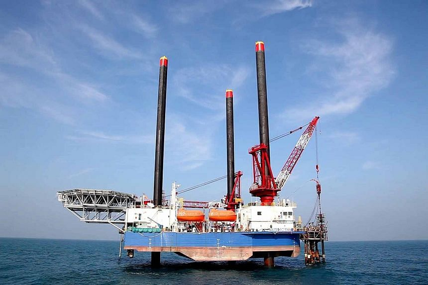 Local oil and gas-related companies remain relatively attractive potential assets for overseas firms as many have made a good name for themselves, including Ezion Holdings (left), one of the largest liftboat operators in the world.