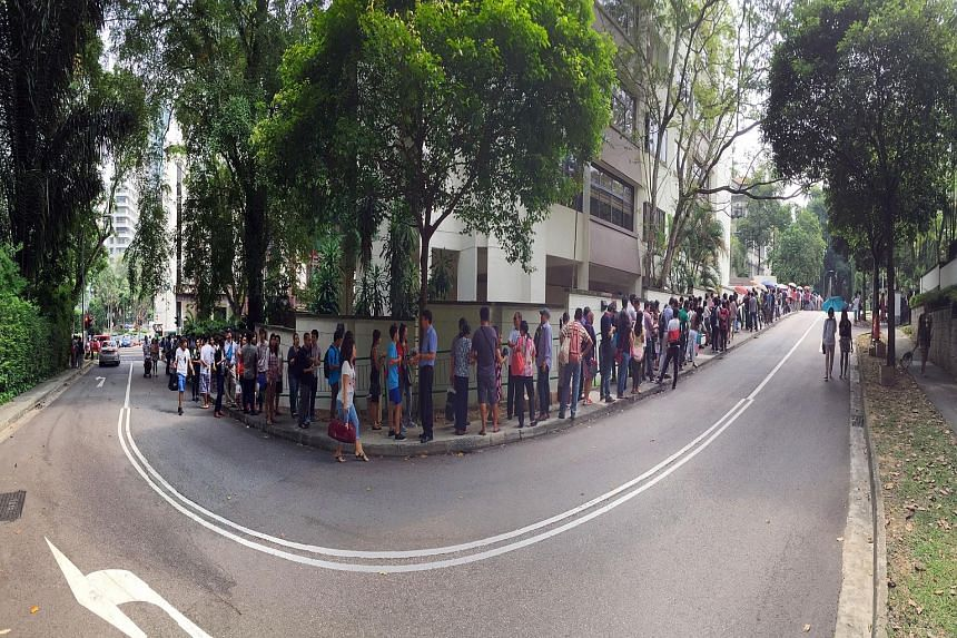Hundreds of Myanmar nationals queueing outside the Myanmar Embassy yesterday to cast their votes for the country's general election on Nov 8. Many queued from as early as 5am outside the embassy in St Martin's Drive off Tanglin Road, according to vol
