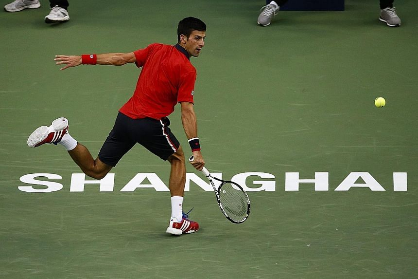 Novak Djokovic playing a running backhand against Feliciano Lopez at the Shanghai Masters yesterday. The world No. 1 stayed on track for a ninth title of the year.