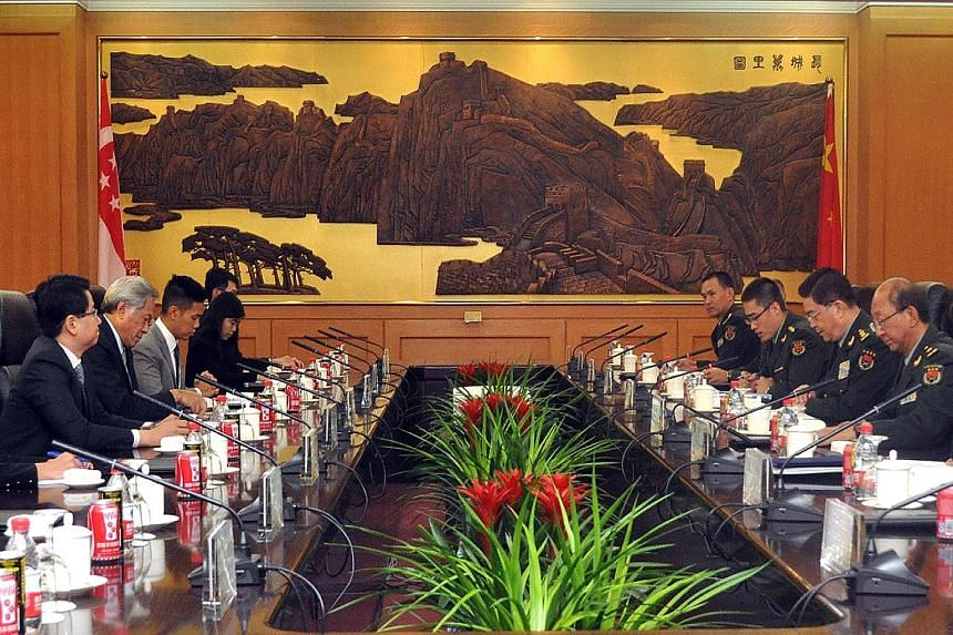Defence Minister Ng Eng Hen (second from left) and his Chinese counterpart, General Chang Wanquan (second from right), at a meeting in Beijing yesterday. They discussed China's constructive role in the regional security architecture through its parti