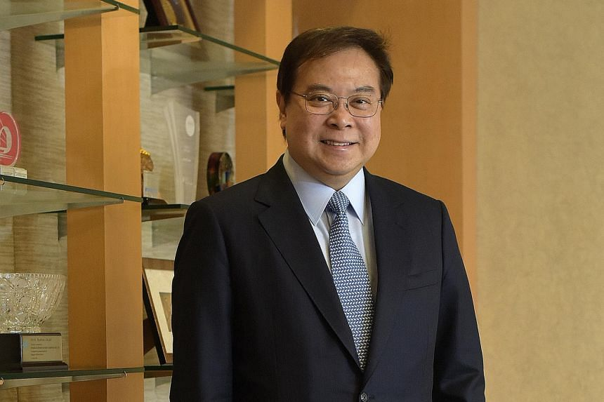 UOB chief executive Wee Ee Cheong (left) and OCBC chief executive Samuel Tsien both feel that the ground for Asean's full integration remains uneven.