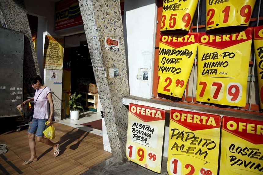 Prices are displayed outside a market in Rio de Janeiro on Sept 24.