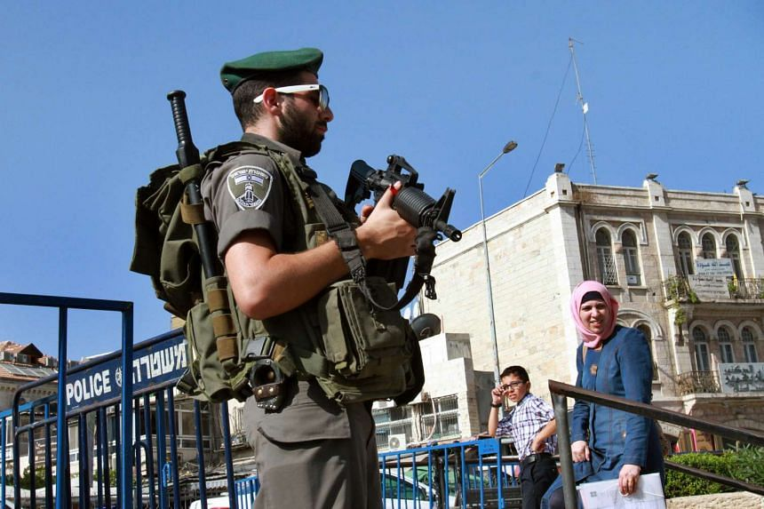 An Israeli border policeman standing guard at the entrance of the Old City in east Jerusalem on Oct 15.