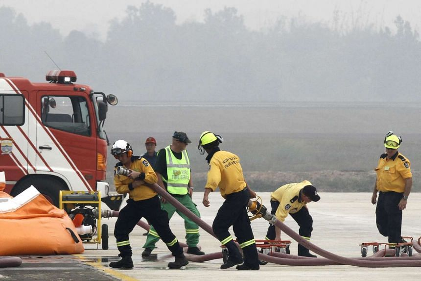 Australian firefighters prepare their equipment in international efforts to assist Indonesia in combating forest fires.