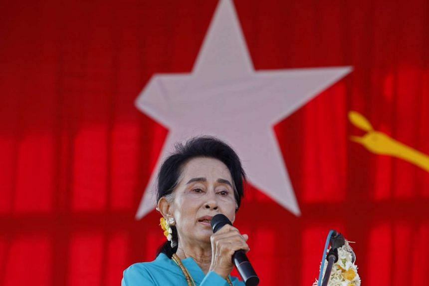 Myanmar opposition leader Aung San Suu Kyi speaking to supporters in Moe Nyin on Oct 4.