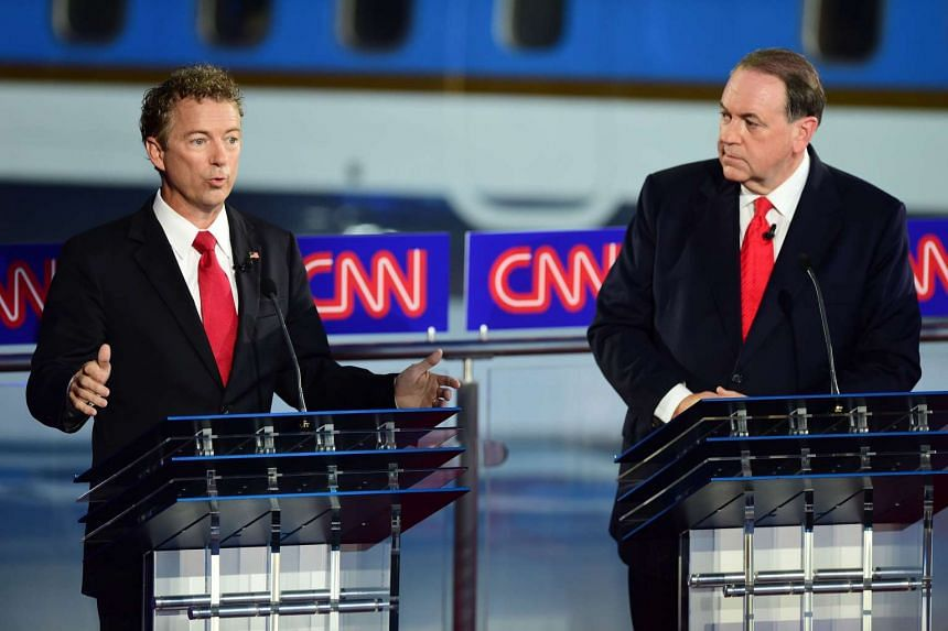 Republican presidential hopefuls Rand Paul (left) and Mike Huckabee are among the six candidates edging toward financial crisis.