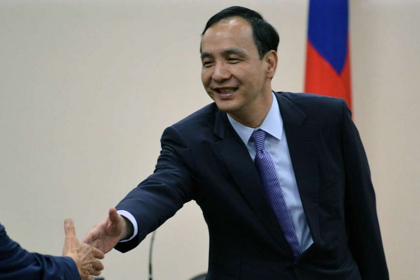 Chairman of the ruling Kuomintang Eric Chu is greeted before the party's central standing committee meeting in Taipei on Oct 7.