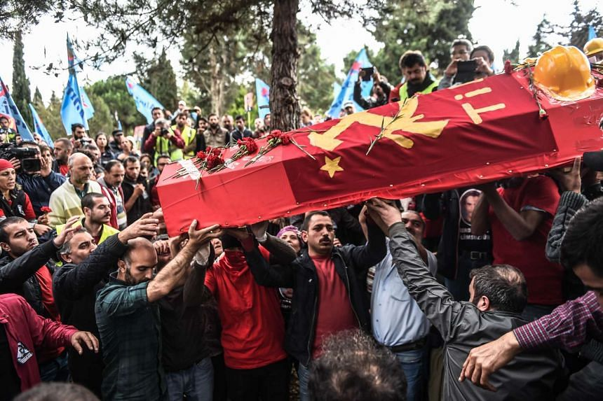 People carry the coffin of Serdar Ben, a victim of the twin bombings in Ankara, during his funeral in Istanbul on Oct 15, 2015.