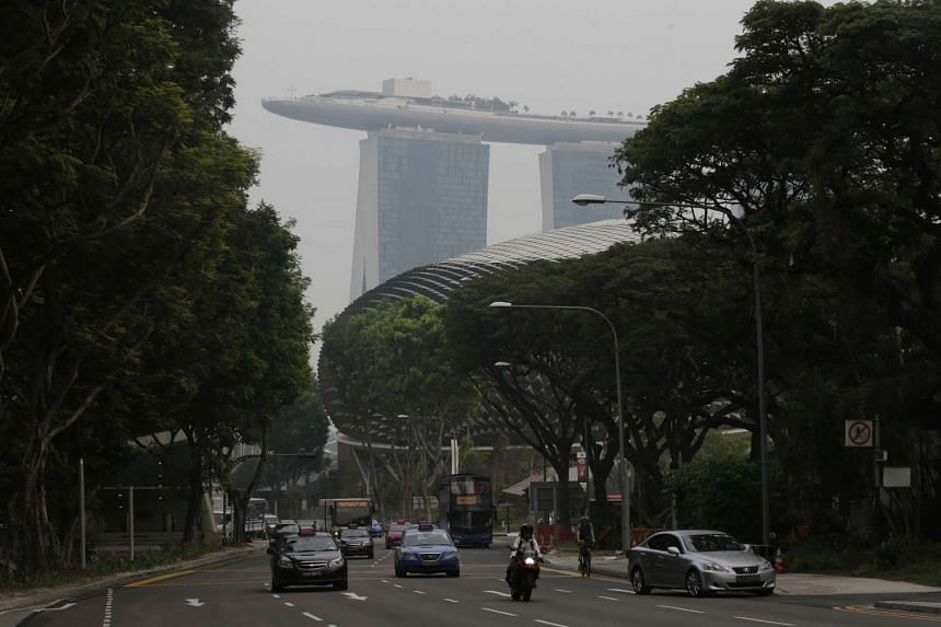 A slight haze is seen against the Esplanade and Marina Bay Sands at 5.35pm on Oct 16, 2015.