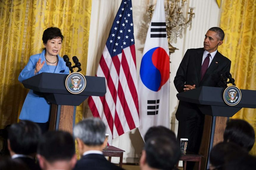 US President Barack Obama listens as South Korean President Park Geun-hye responds to a question from the news media during a joint press conference in the East Room of the White House in Washington, DC, USA, on Oct 16, 2015.