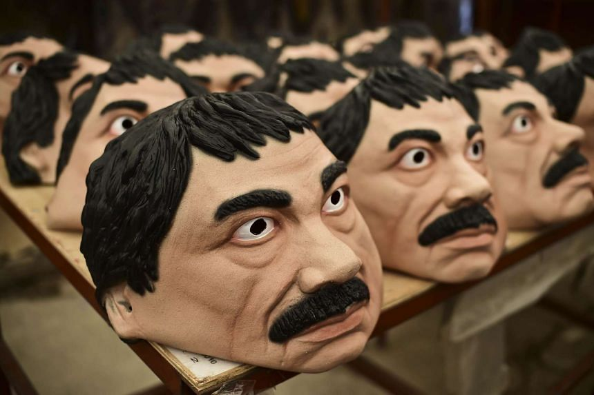 """Masks of the Mexican drug trafficker Joaquin Guzman Loera aka """"El Chapo"""" are pictured in a factory of costumes and masks, on Oct 16, 2015, in Jiutepec, Morelos State."""