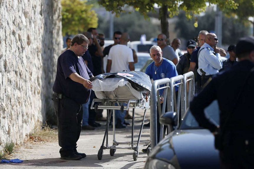 Israeli medics carrying away the body of a Palestinian man who attempted to stab a soldier in the east Jerusalem Jewish settlement of Armon Hanatsiv, adjacent to the Palestinian neighbourhood of Jabal Mukaber, on Oct 17, 2015. Israeli police spokesma